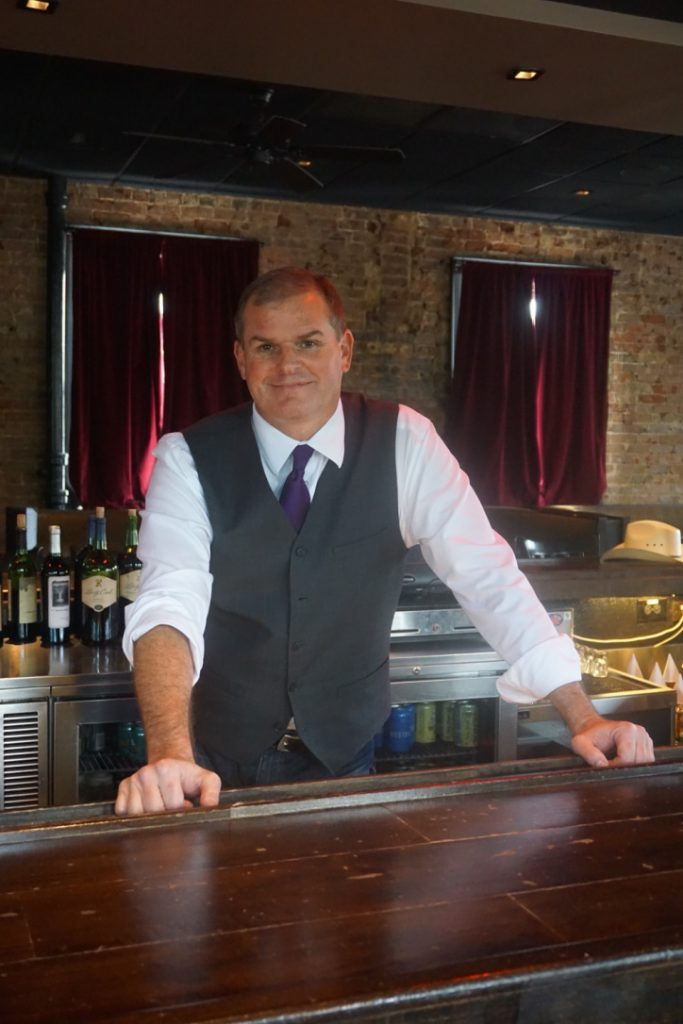 Robert Gardiner behind the bar